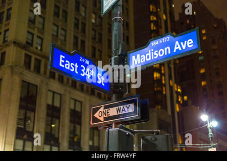 NYC signpost in Midtown Manhattan at landmark streets Madison Ave and 34th St - Stock Photo