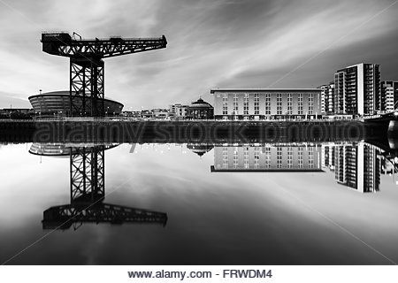 A black and white shot taken at Sunset from the River Clyde with the Finnieston crane reflecting on the still water. - Stock Photo