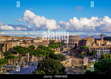 View of the Via dei Fori Imperiali with the Colosseum in the distance, as seen from the Altare della Patria, Rome - Stock Photo