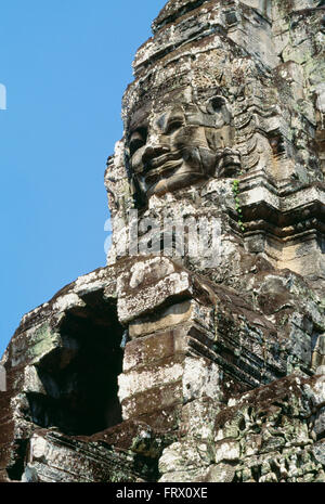 Detail of Faces Carved in Stone, the Bayon Temple, Angkor Thom, (Temples of Angkor) Cambodia - Stock Photo