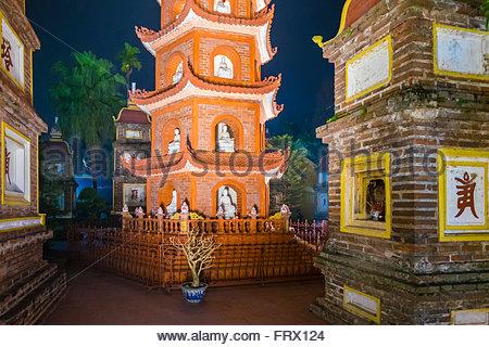 Tran Quoc Pagoda (Chua Tran Quoc) at night, Tay Ho District, Hanoi, Vietnam - Stock Photo