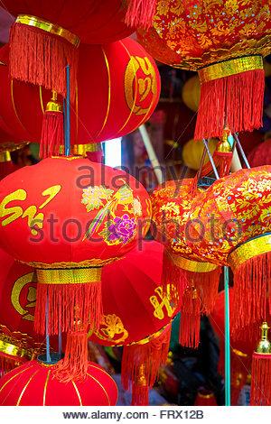Red silk lanterns for sale during Vietnamese New Year (Tet), Hoan Kiem District, Old Quarter, Hanoi, Vietnam - Stock Photo