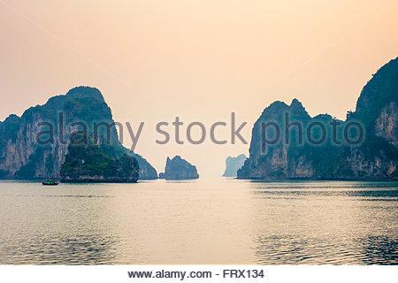 Karst mountain landscape in Ha Long Bay after sunset, Quảng Ninh Province, Vietnam - Stock Photo