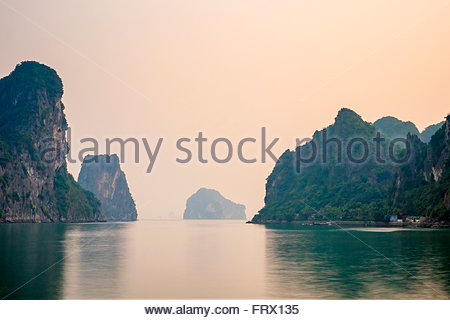 Karst mountain landscape in Ha Long Bay after sunset, Quang Ninh Province, Vietnam - Stock Photo