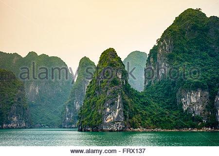 Karst mountain landscape in Ha Long Bay, Quang Ninh Province, Vietnam - Stock Photo