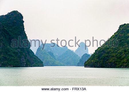 Karst mountain landscape in Ha Long Bay near Cat Ba Island, Quang Ninh Province, Vietnam - Stock Photo