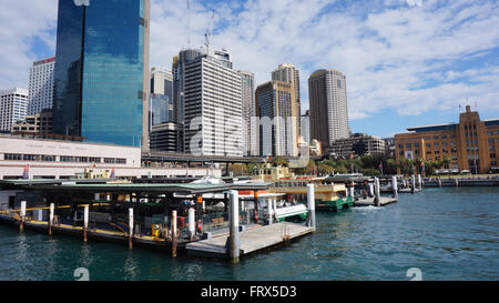 SYDNEY - AUG 22: Sydney city central business district view from harbour ferry over bay blue skyline on August 22, - Stock Photo