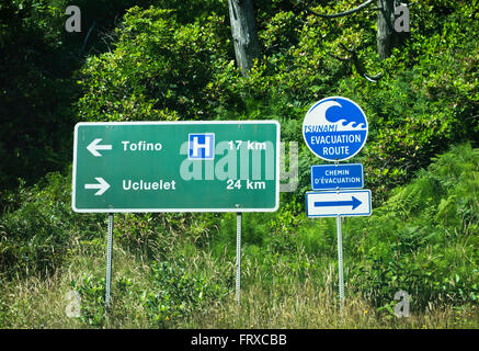 Sign for Tofino and Ucluelet and for the Tsunami Evacuation Route.  Bilingual in French writing. Long Beach, BC, - Stock Photo