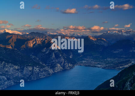 Lake Garda with Riva and view to Lake Garda range, Adamello range, Presanella range, Brenta range and valley of - Stock Photo