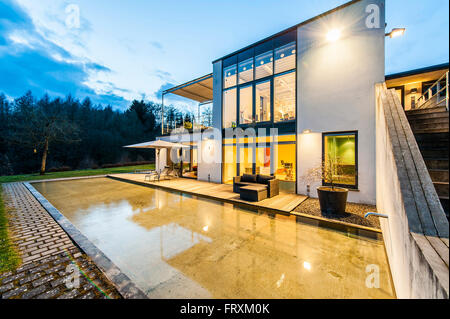 bauhaus villa at dusk sauerland germany stock photo - Villa Sauerland