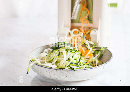 Raw zucchini and carrot spaghetti cut with spiral slicer - Stock Photo