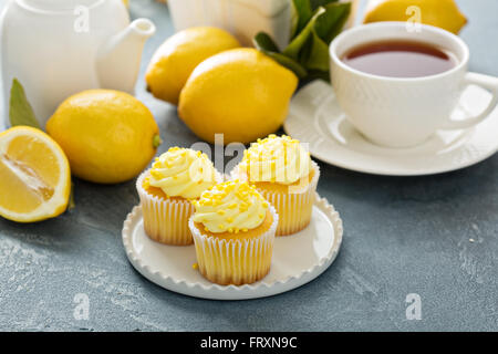 Lemon cupcakes with bright yellow frosting - Stock Photo