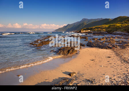 A beautiful beach on the subtropical island of Yakushima (屋久島), Japan. Photographed in early morning sunlight. - Stock Photo