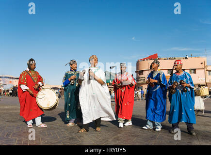 Musicians in colourful clothes at the Jemaa el-Fnaa square in Marrakesh, Morocco - Stock Photo