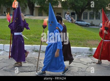Children dressed as hooded farricocos participate in a religious procession known as the Procession of Torches during - Stock Photo