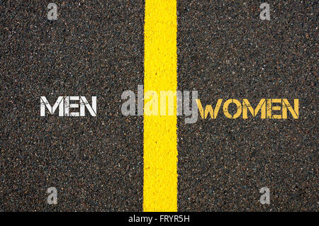 Antonym concept of MEN versus WOMEN written over tarmac, road marking yellow paint separating line between words - Stock Photo