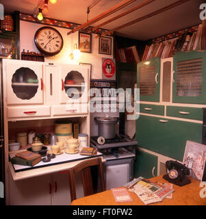 Vintage cabinets and gas cooker in fifties kitchen - Stock Photo