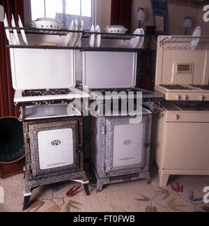 Collection of vintage gas cookers in fifties kitchen - Stock Photo