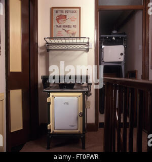 Collection of vintage gas cookers on fifties landing - Stock Photo