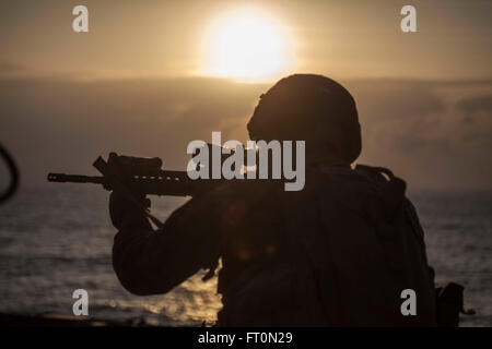 A Marine with Battalion Landing Team 1st Battalion, 5th Marines, 31st Marine Expeditionary Unit, fires at his target - Stock Photo