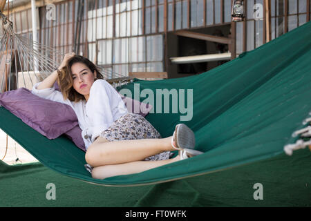 Young Woman Resting on Hammock