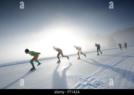 Ice speed skaters on lake Weissensee, Alternative Eleven cities tour, Weissensee, Carinthia, Austria - Stock Photo