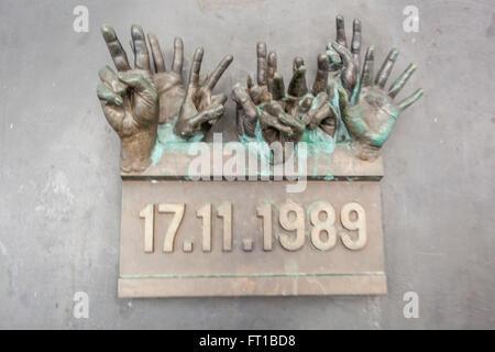 Bronze sculpture,hands resembling 'massacre' on Narodni Street, the beginning of the Czech Velvet Revolution in - Stock Photo