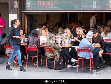 Alfresco dining at a bar restaurant in Soho in New York City - Stock Photo