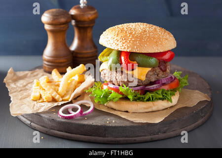 homemade cheese burger with peppers tomato onion - Stock Photo
