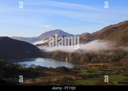 Scenic view along valley to Llyn Gwynant lake and Yr Aran with mist in mountains of Snowdonia National Park. Nantgwynant Wales