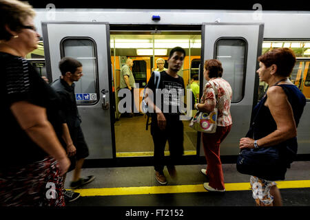 People getting on and off the U-Bahn subway train carriage in Vienna, Austria, Europe - Stock Photo
