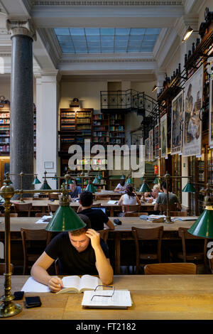 Young man studying at the University of Vienna library, Austria, Europe - Stock Photo