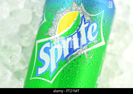 Sprite drink in a can on ice isolated on white background - Stock Photo