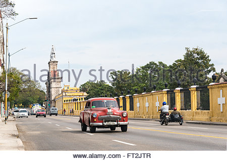 Old obsolete vehicles in Colon Cemetery landmark.  Both, Cars and the tombs field are major tourist attractions - Stock Photo