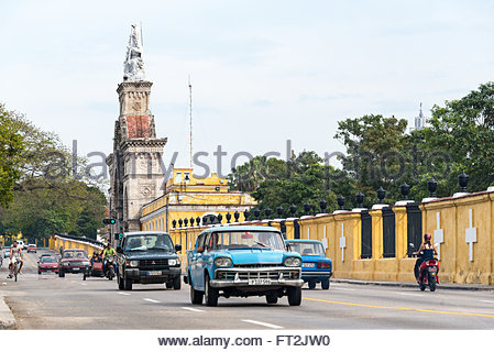 Old obsolete vehicles in Colon Cementery landmark.  Both, Cars and the tombs field are major tourist attractions - Stock Photo
