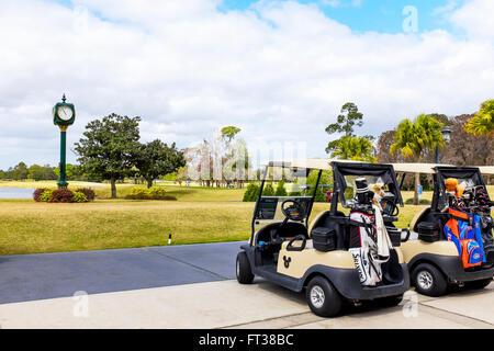 Golf cart on Disney's Magnolia Golf Club, Lake Buena Vista, Orlando Florida, USA - Stock Photo