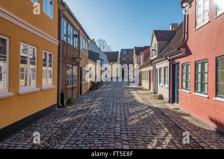 Old homes in cobbled streets in Odense, the city of Hans Christian Andersen, Denmark - Stock Photo