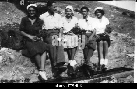 Group of 1920s italian saylors males and females taken in summer close to the Italy coast - Stock Photo