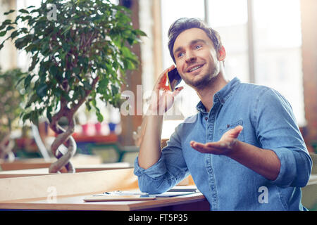 Content man talking on mobile phone - Stock Photo
