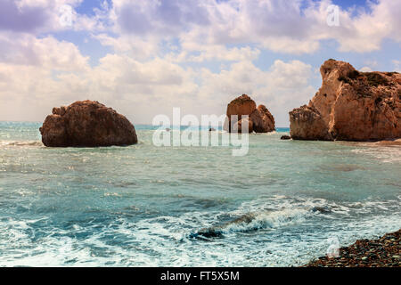 Seascape with Petra tou Romiou, also known as Aphrodite's Rock, is a sea stack in Pafos, Cyprus. - Stock Photo