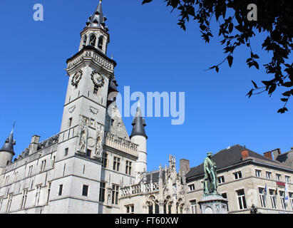 AALST, BEGIUM, MARCH 17 2016: Historic buildings on the main market square in Aalst, including the medieval belfry. - Stock Photo