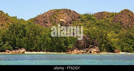Beautiful Huge granite boulders on beach at Curieuse Island in Indian Ocean. - Stock Photo