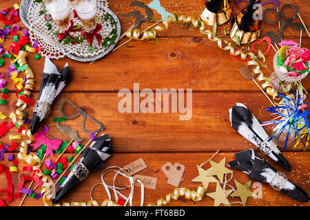 Directly above shot of Christmas decorations on wooden table - Stock Photo