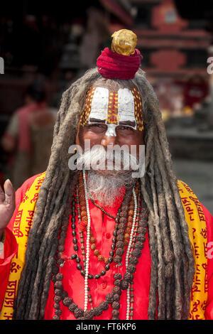 Nepal, Kathmandu.  A Sadhu (Hindu Ascetic) in Durbar Square.  Trident marks him as a devotee of Shiva. - Stock Photo