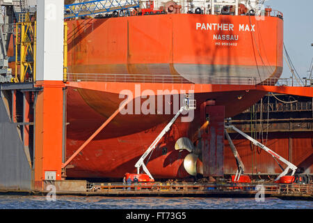 Cargo ship in the dry dock of Blohm und Voss, Hamburg, Germany, Europe - Stock Photo