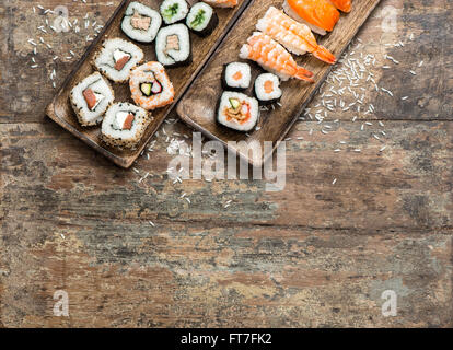 Traditional japanese food. Sushi rolls, maki, nigiri on wooden background - Stock Photo