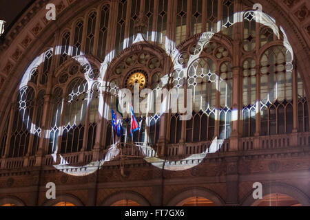 Light projection of the five-ringed Olympic symbol on Porta Nuova train station facade during 2006 Turin Olympic - Stock Photo