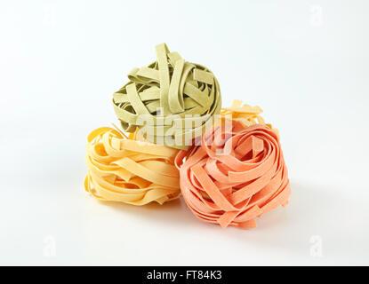 Bundles of dried ribbon pasta - Stock Photo