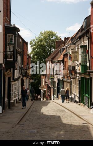 Steep Hill, a very steep road from the end of High Street leading up to The Cathedral and Castle in Lincoln - Stock Photo