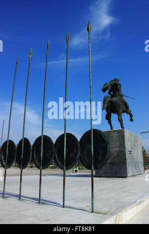 Monument of Alexander the Great commander and Greek hero on his horse Bucephalus with row of spears and shields - Stock Photo